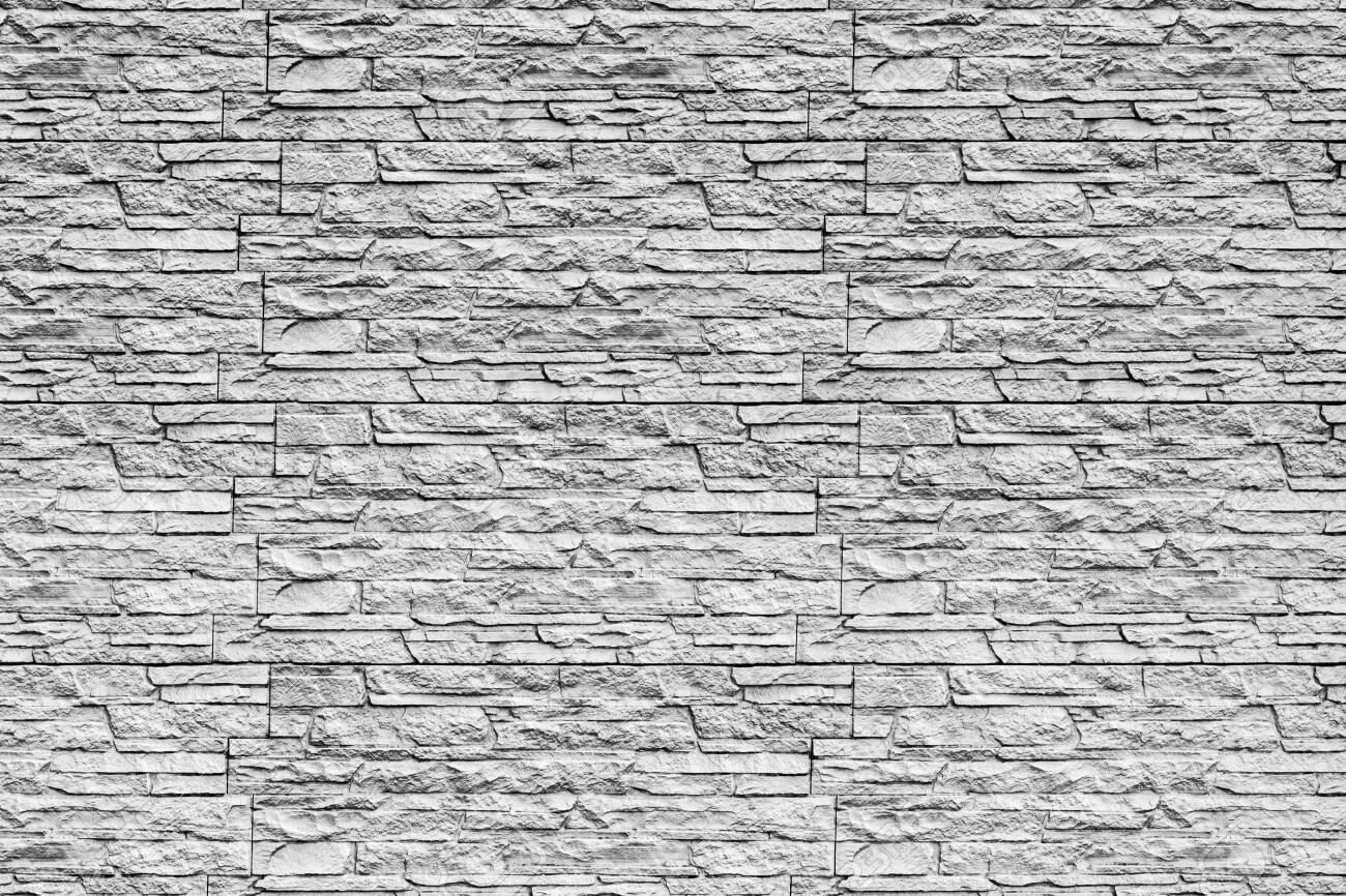 Black and white texture of a wall covered with decorative brick-like tiles. Abstract monochrome background for design. - 155277758