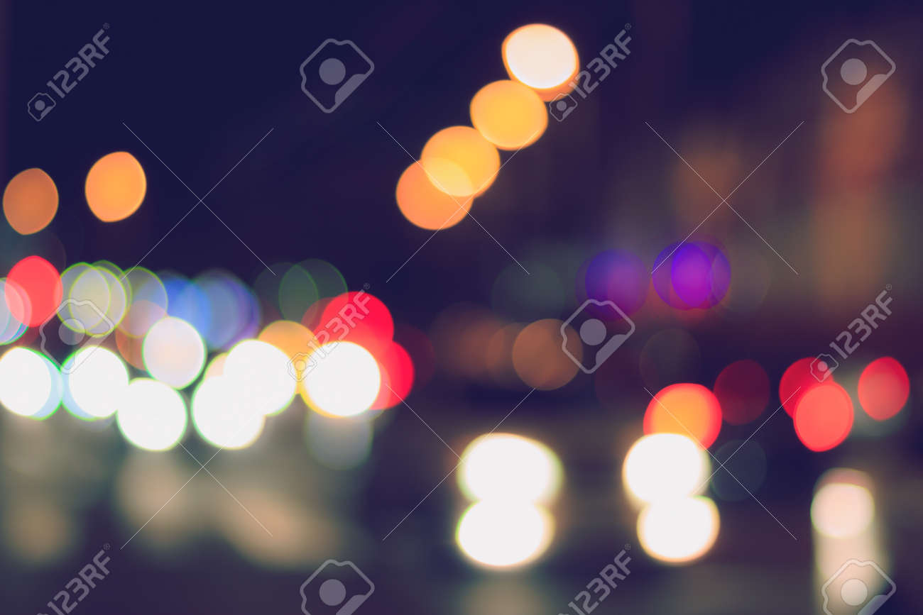 Blurred lights of headlights of cars and lanterns in the night city. Abstract bright bokeh. - 158007817
