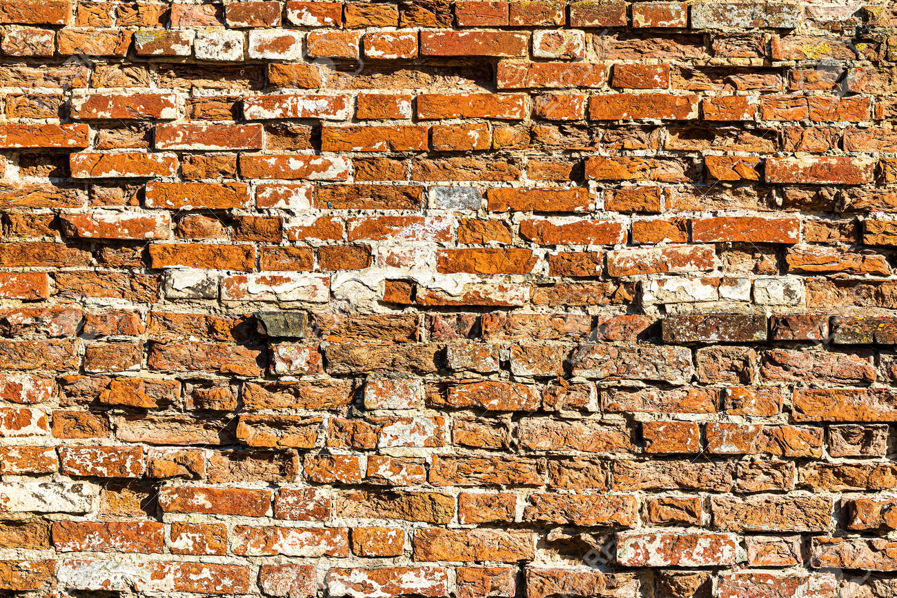 Wall texture from red old damaged bricks. Abstract background for design. - 169566565