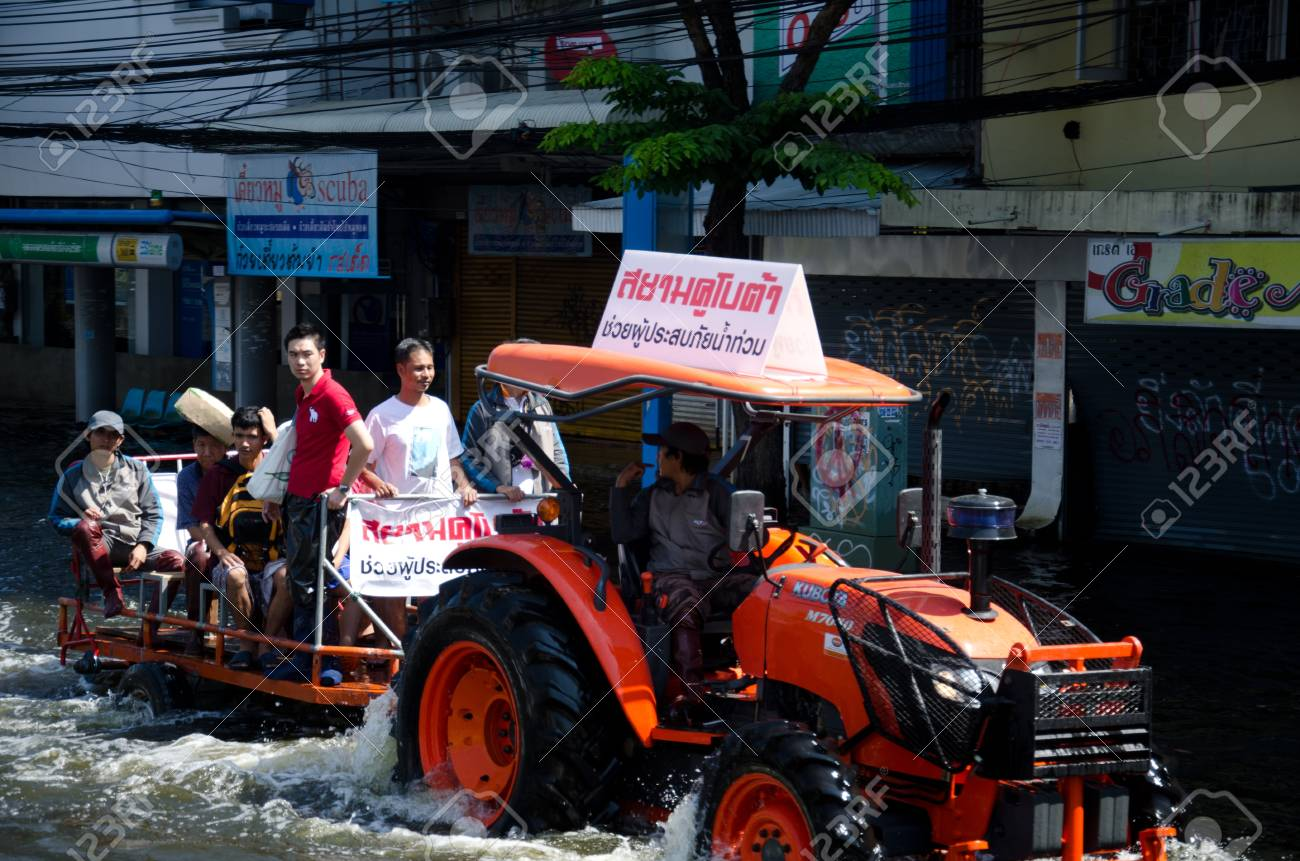 BANGKOK THAILAND � NOVEMBER 13: Truck carries a group of people to evacuate from the flooded area at Phahon Yothin Road during the massive flood crisis on November 13, 2011 in Bangkok, Thailand. Stock Photo - 11201060