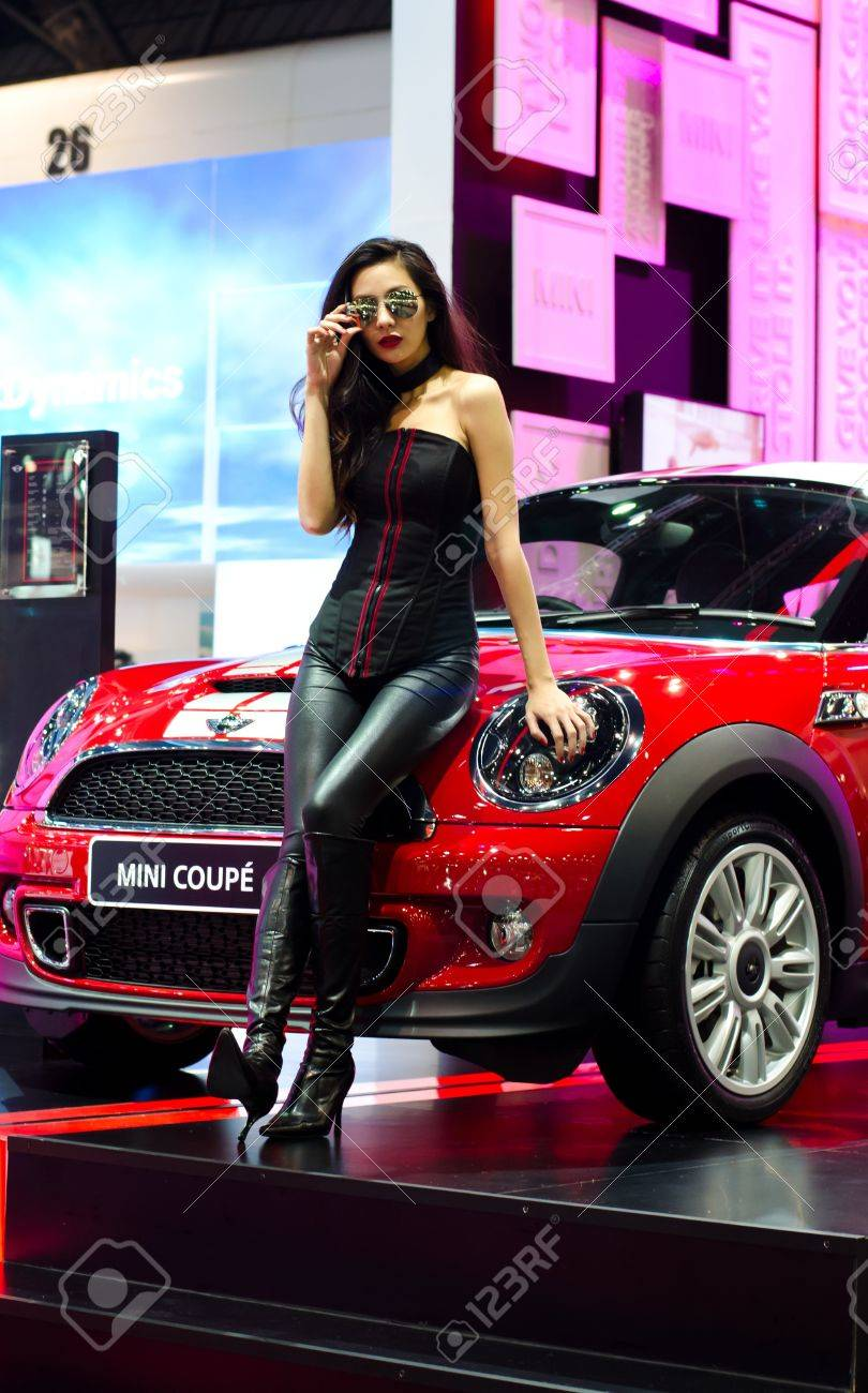 BANGKOK - DECEMBER 3: Mini coupe car  with unidentified model on display at the 28th Thailand International Motor Expo on December 3, 2011 in Bangkok, Thailand. Stock Photo - 11379325