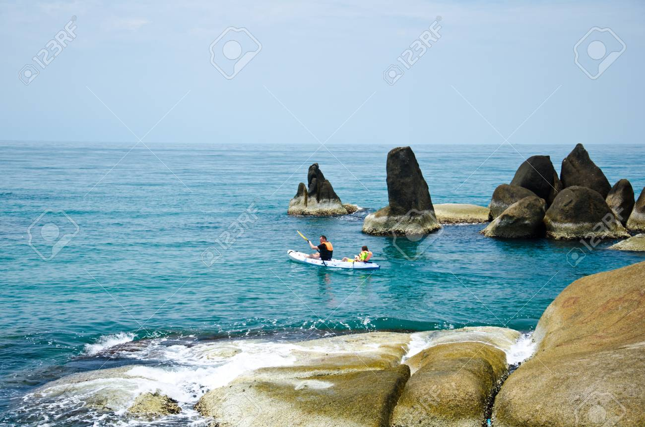 Traveler kayaking in the Gulf of Thailand. Samui Island, Surat Thani Province, Thailand. Stock Photo - 13365179