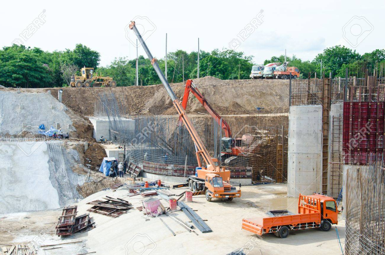 Crane standing on a construction site under construction floodgate Stock Photo - 14759996