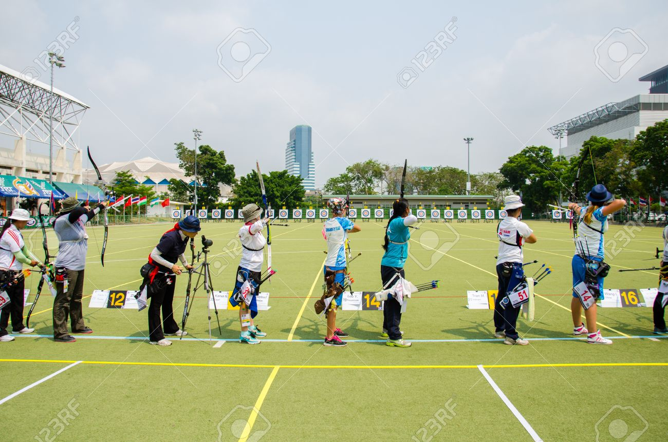 BANGKOK -MARCH 19: Unidentified archers in a row and shootin 2015 Asia Cup-World Ranking Tournament (stage II) at Hua Mak Sports Complex on March 19, 2015 in Bangkok, Thailand. - 37796918