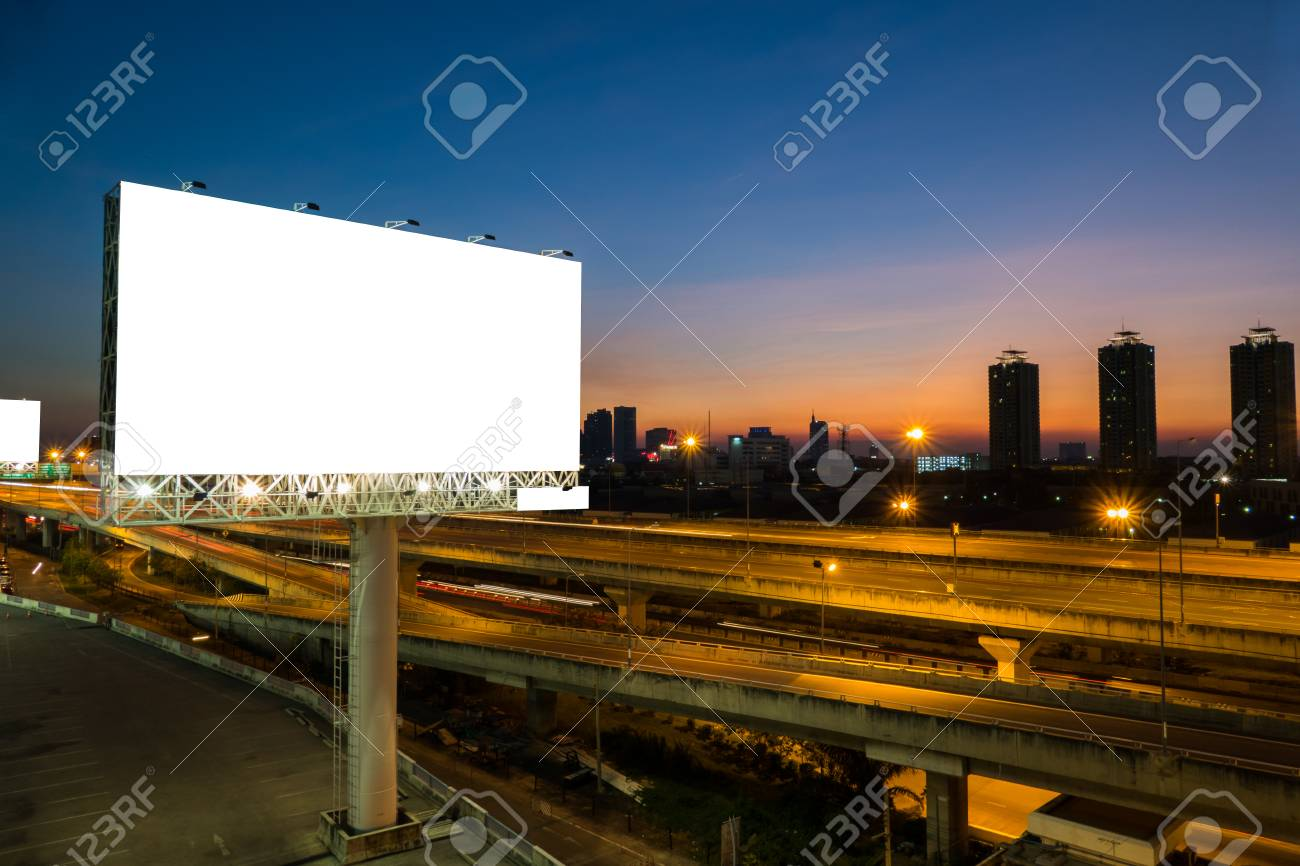 Advertising blank billboard on sidelines of expressway at twilight for advertisement. - 55395526