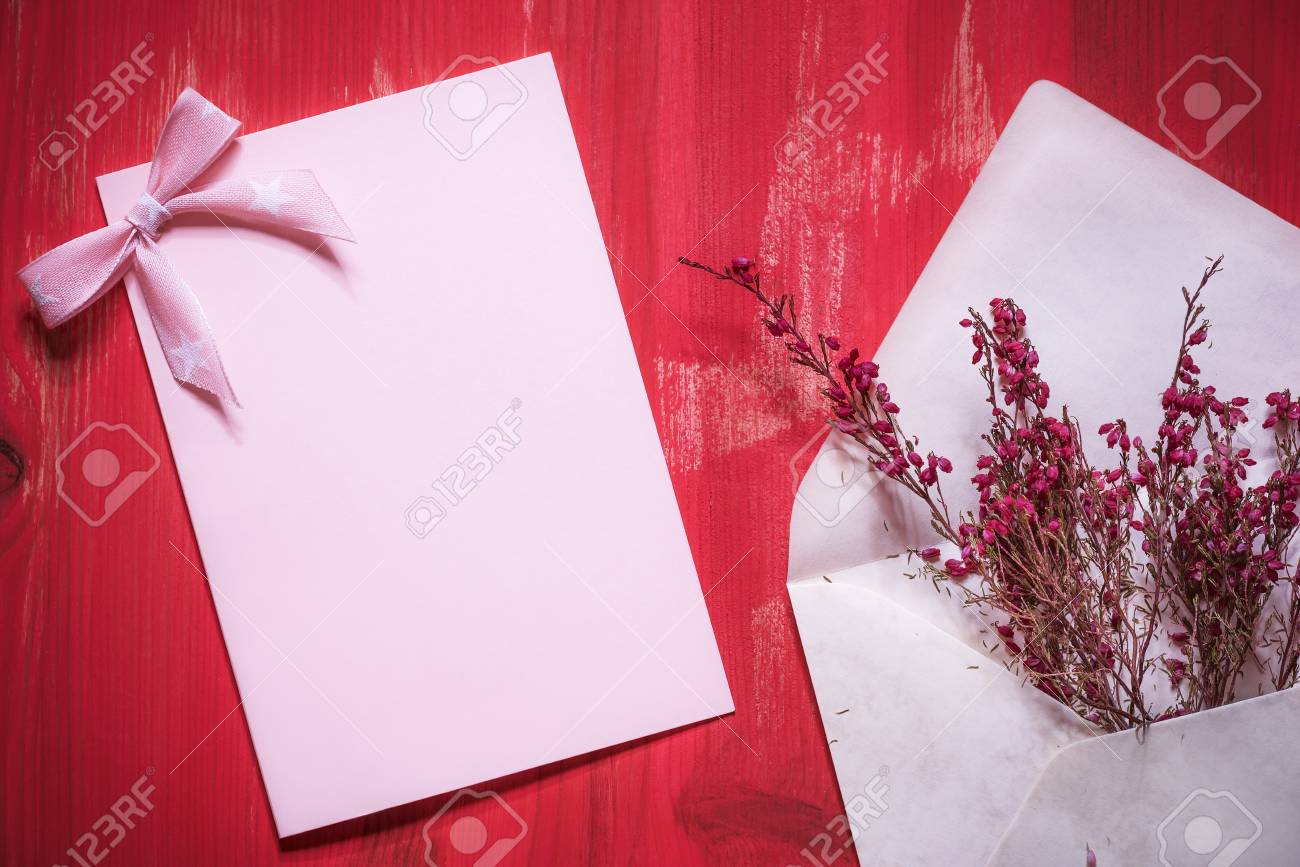 Greeting card idea with an open envelope full of beautiful red greeting card idea with an open envelope full of beautiful red flowers near an empty pink m4hsunfo