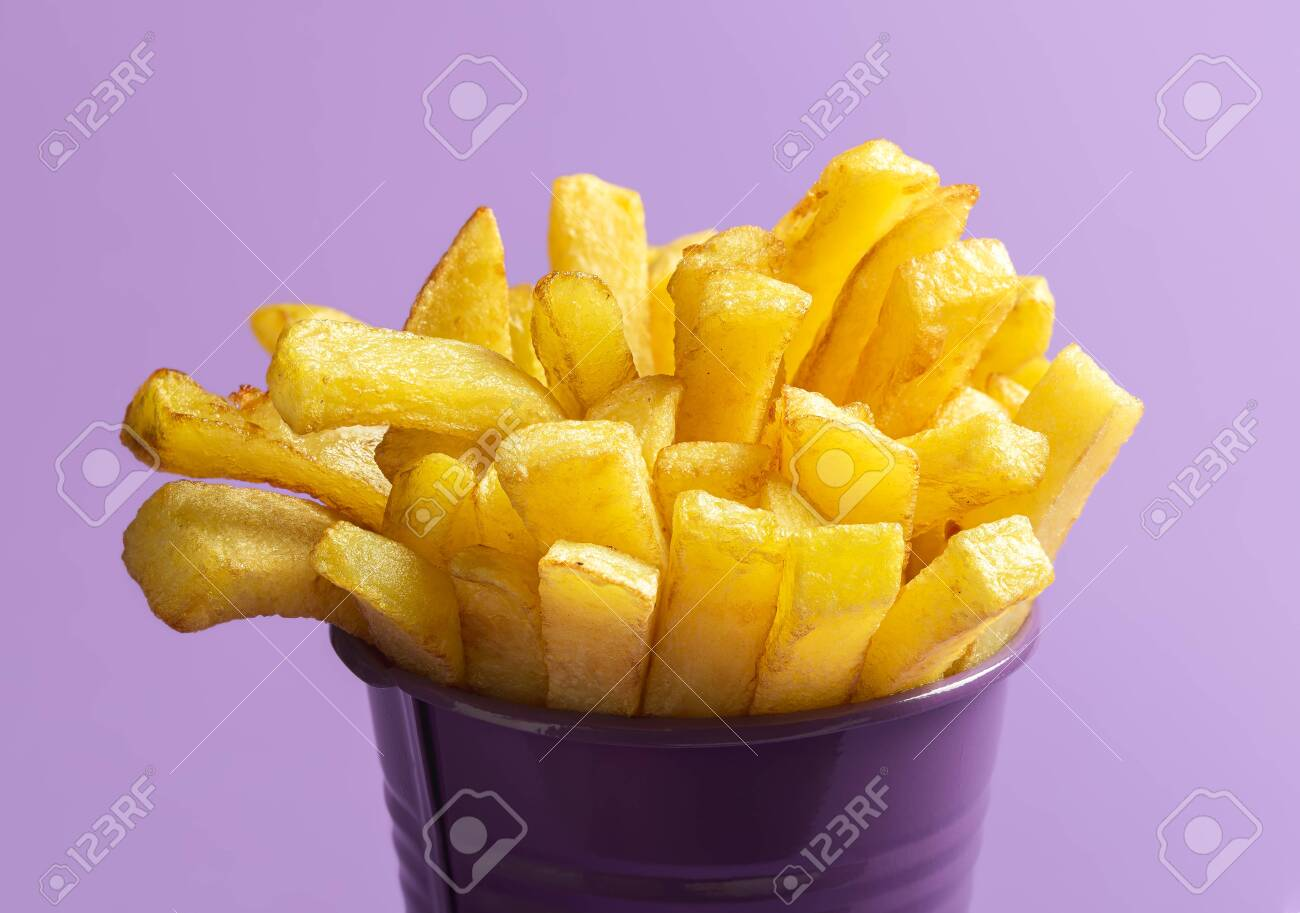 Homemade French Fries Close Up Isolated On Purple Background Stock Photo Picture And Royalty Free Image Image 151265696