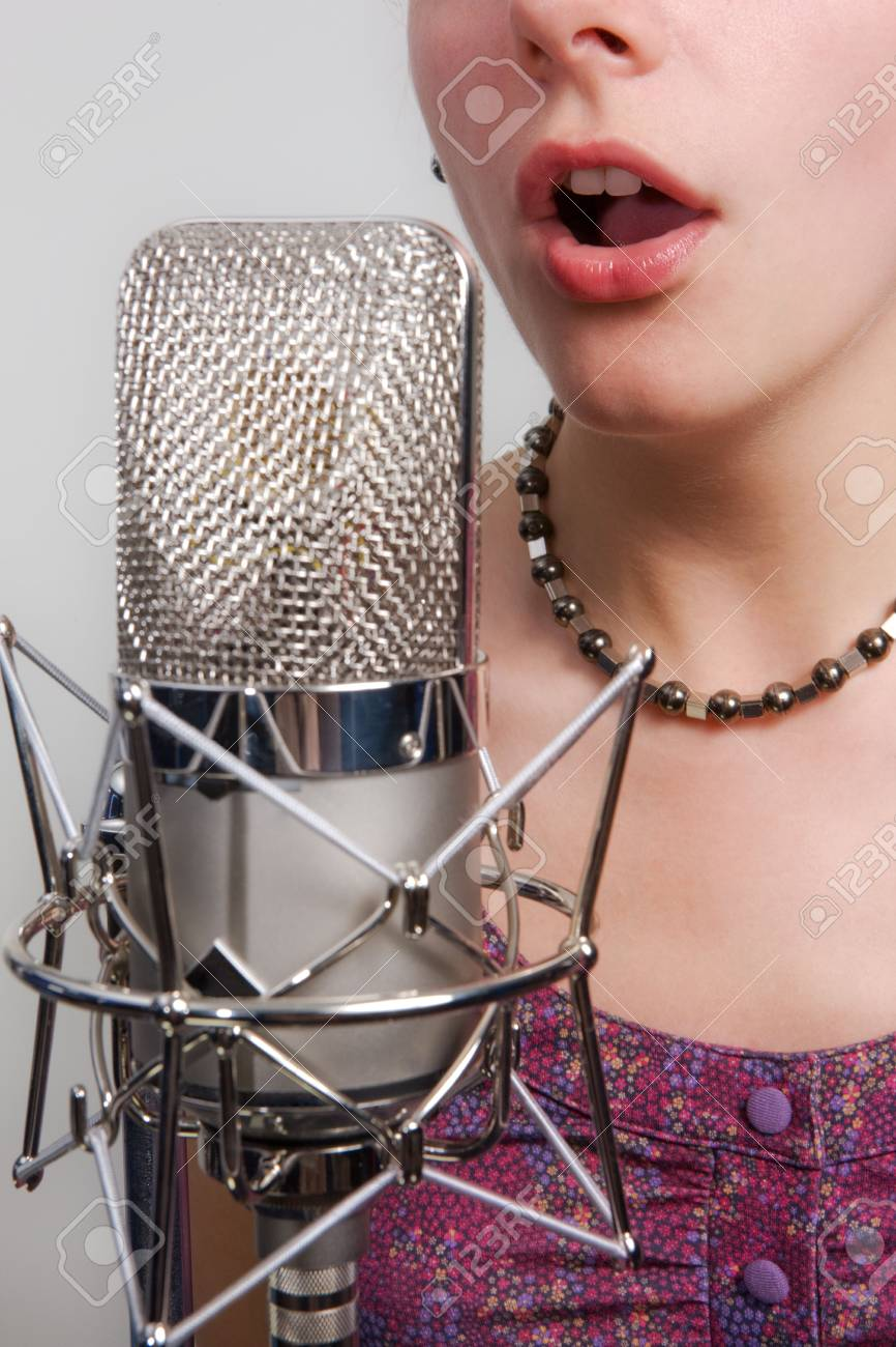 Girl with vintage microphone Stock Photo - 3140467