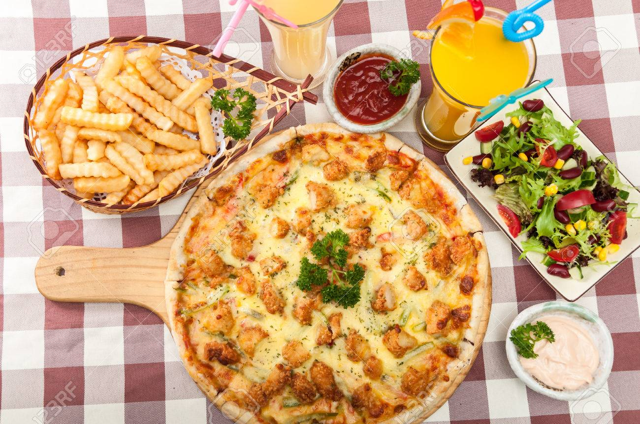 Chicken pizza, French fries, salad and juice - 52572190
