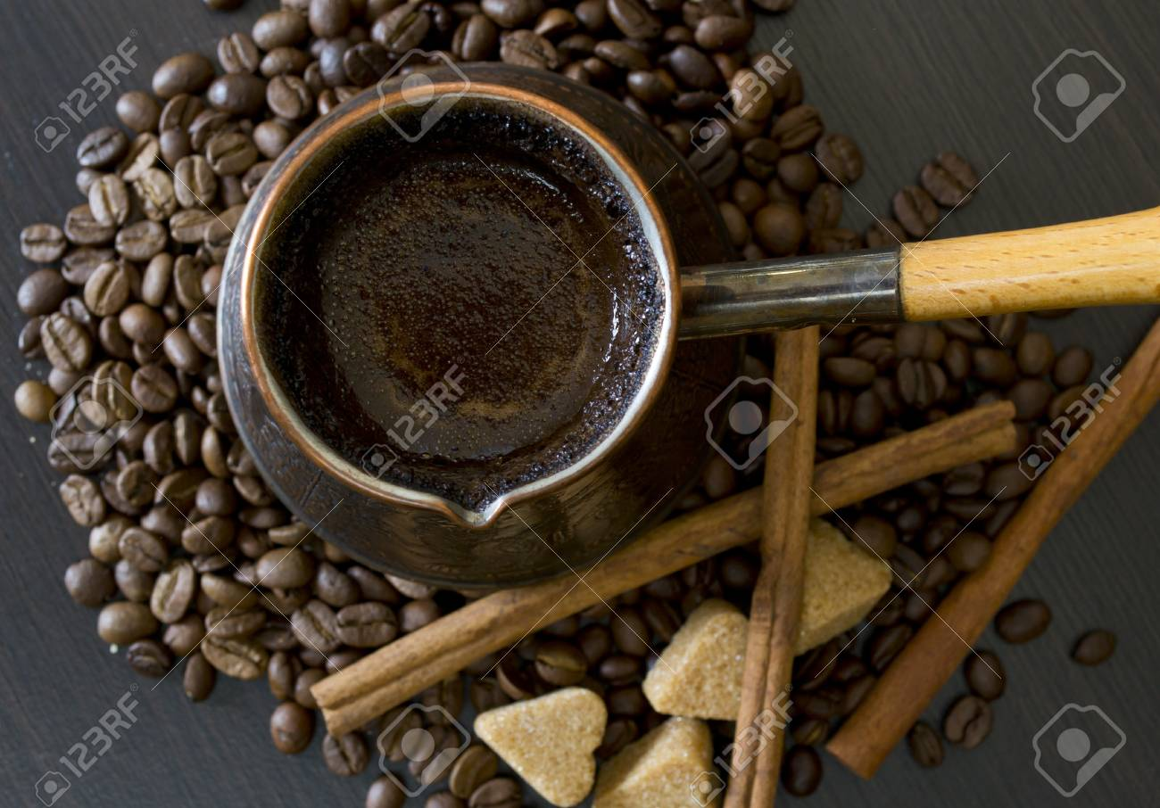 coffee beans, Pots, cinnamon on dark background Stock Photo - 15026781