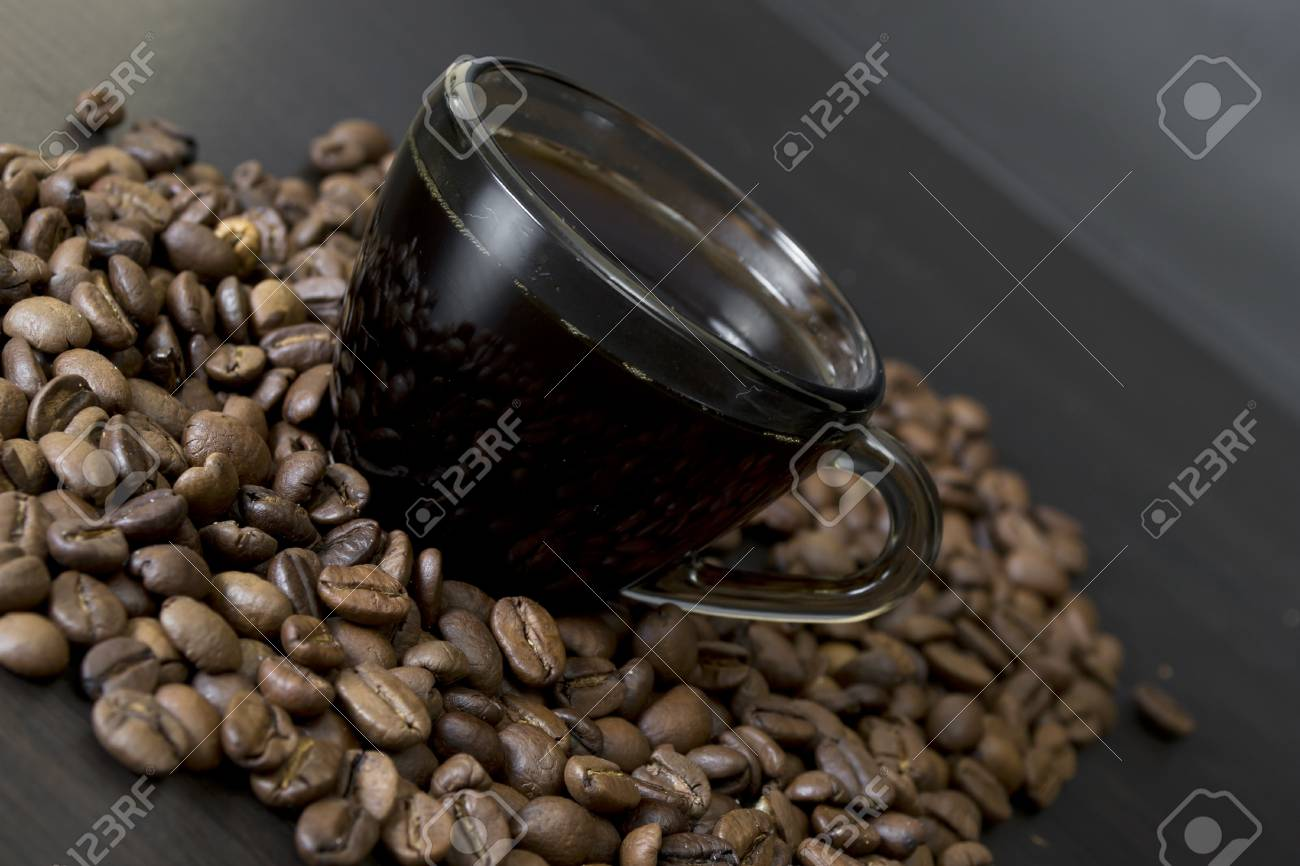 coffee beans, cup, Pots, cinnamon on dark background Stock Photo - 16942560
