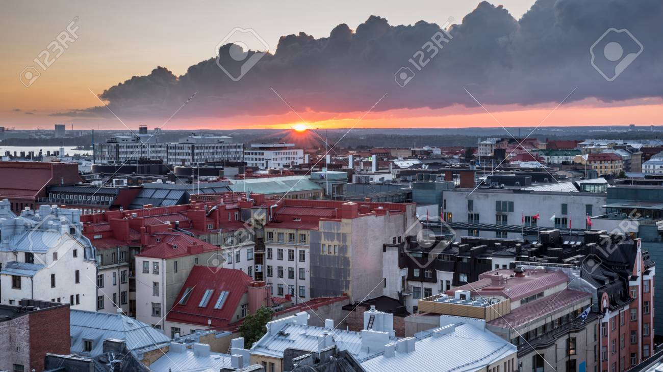 9cb7b3b86f0 Helsinki rooftops at Sunset with dark clouds. Aerial view of Design  District Helsinki