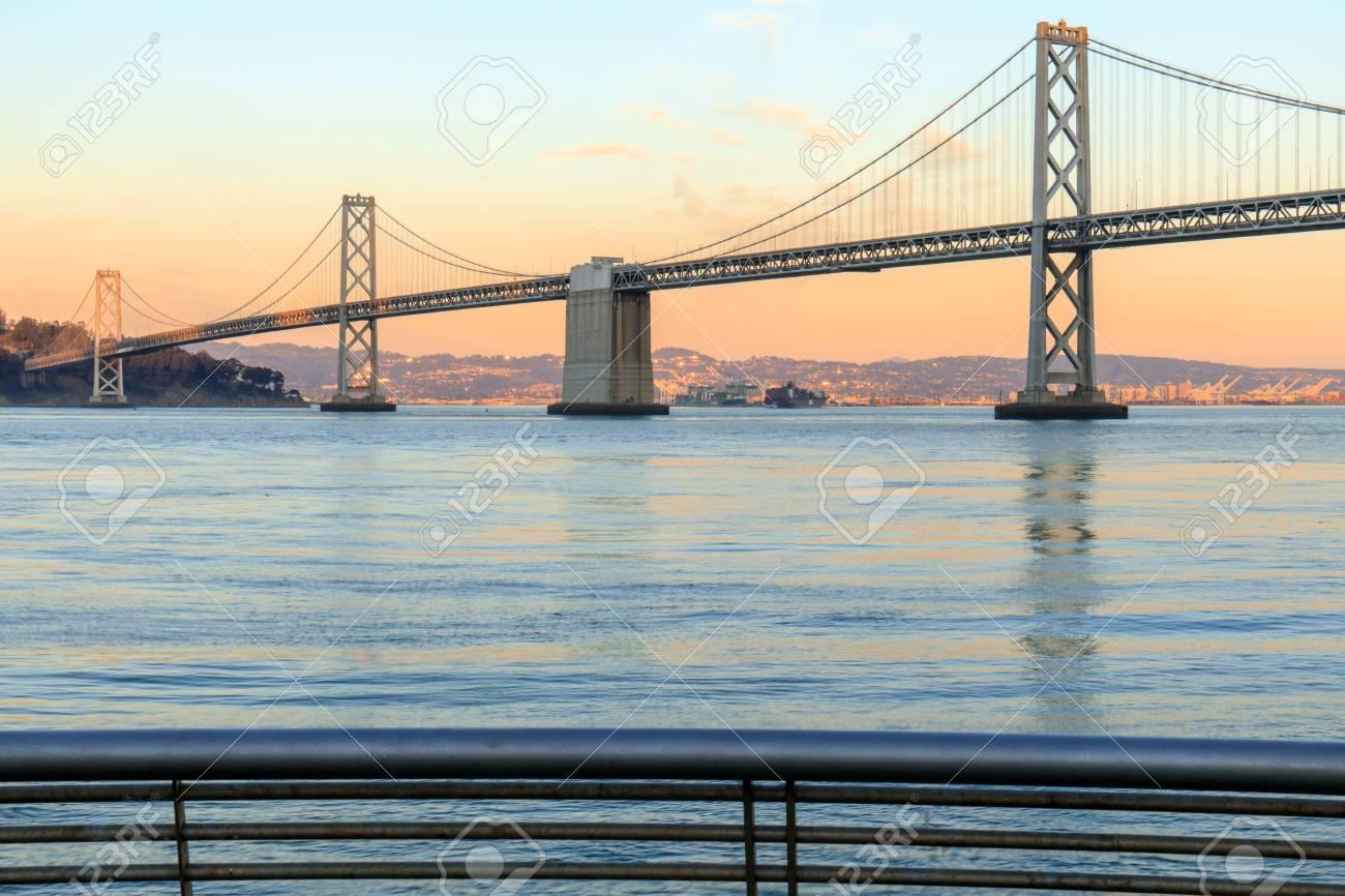 San Francisco Bay Bridge and Pier 14 Rails at Sunset  The Embarcadero,
