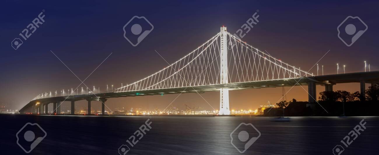 Eastern span of San-Francisco-Oakland Bay Bridge panoramic view at Night. Shot from Treasure Island, San Francisco, California, USA. - 149787310