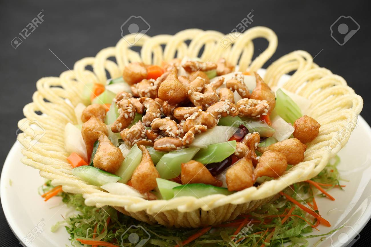 Chinese Cuisine Served On A Plate With Food Decoration Stock Photo