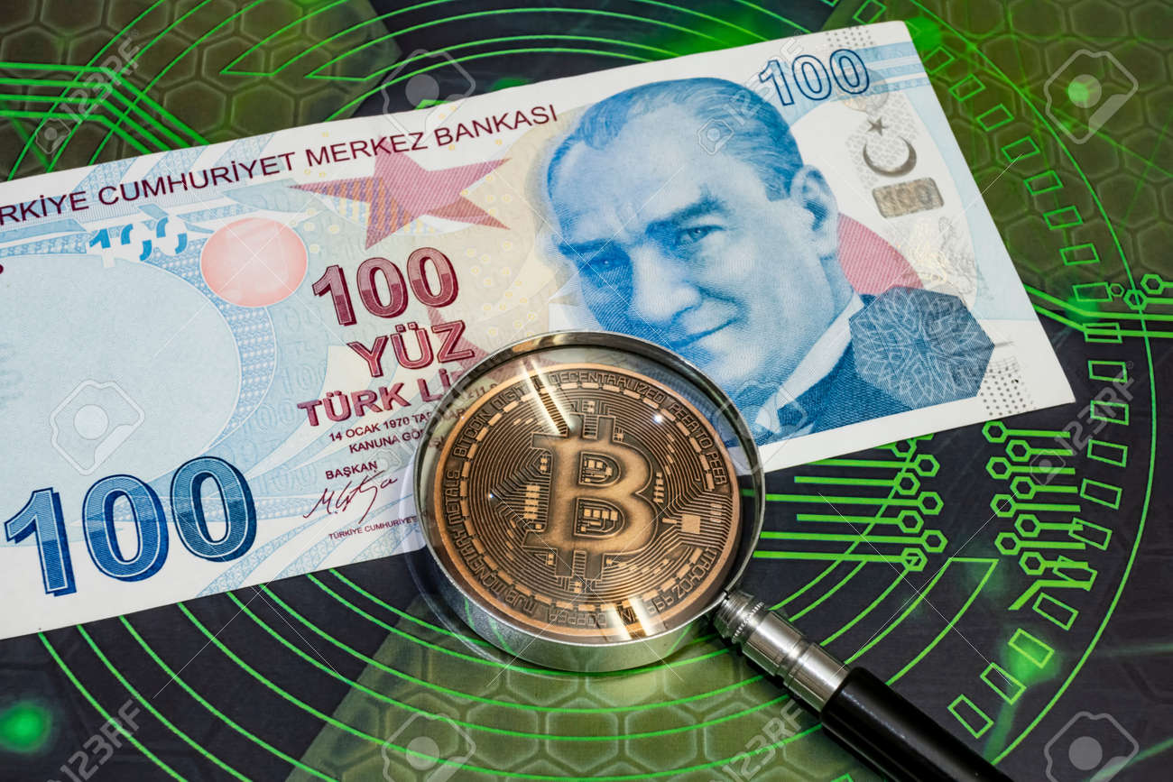 close up bitcoin coin and magnifying glass with turkish lira banknotes on background - 140693740