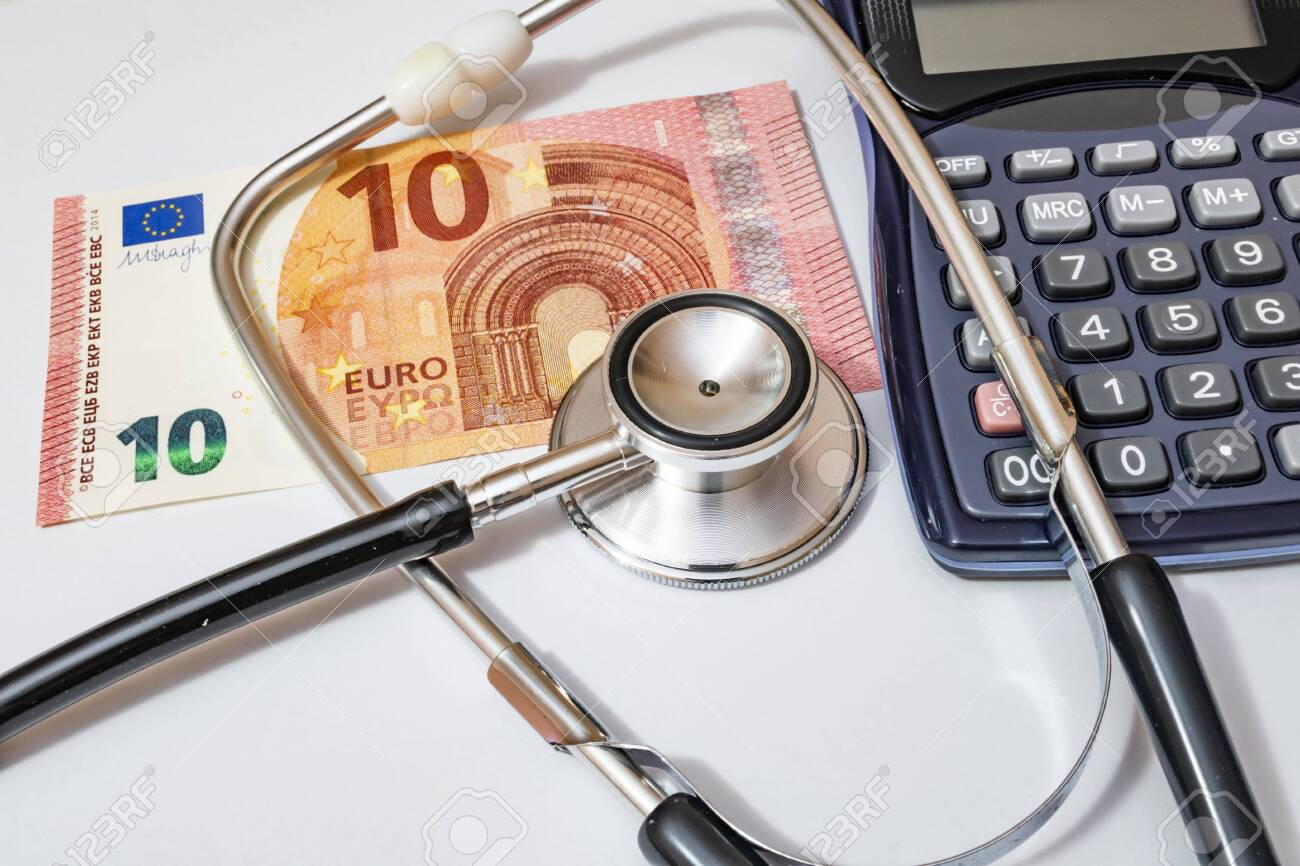 close up currency paper banknote on white background with stethoscope and calculator. - 147463825