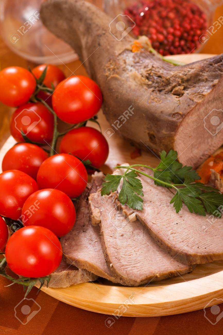 Sliced beef tongue with tomatoes Stock Photo - 18502655