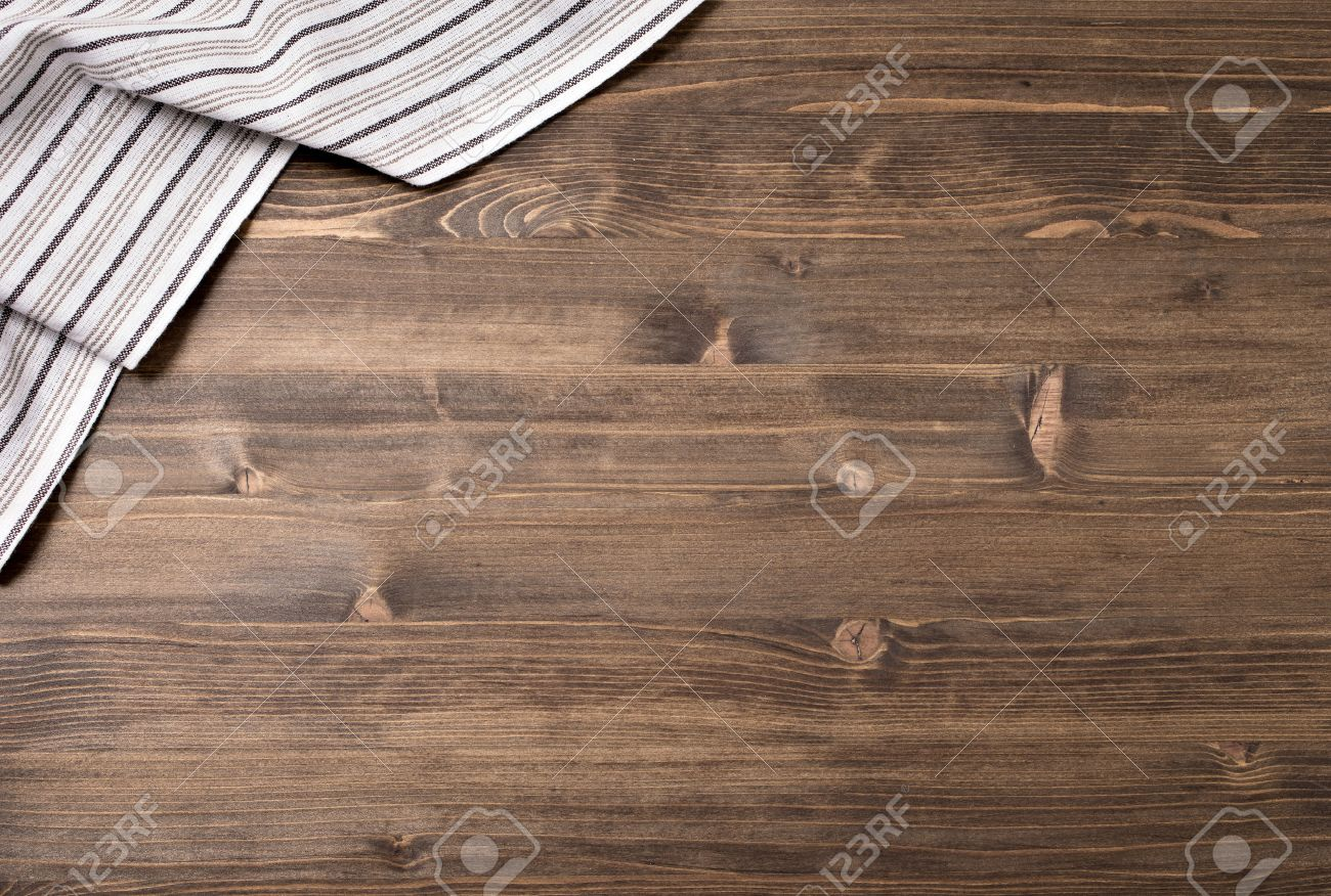 Kitchen table top view - Stock Photo Striped Kitchen Towel From Left Top Corner Of Wooden Table Top View Food Background