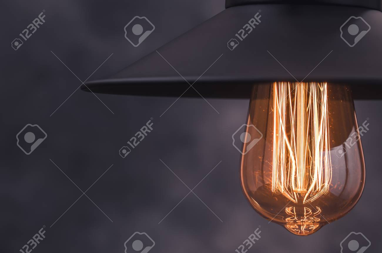 retro light lamp with edison light bulb from right border of stock