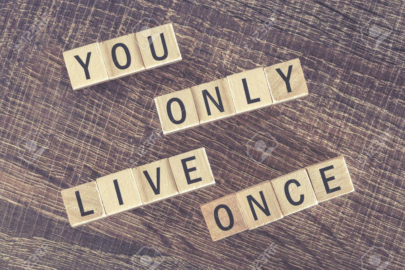 You Only Live Once YOLO message written with wooden blocks on