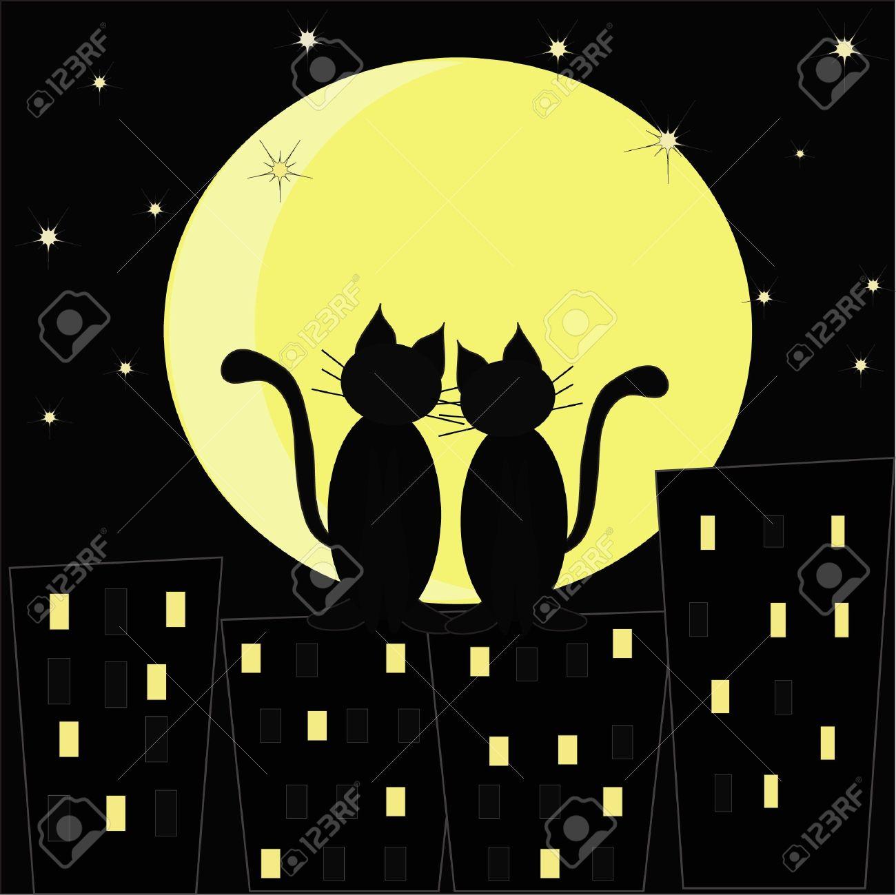 Foto de archivo , Siluetas de dos gatos enamorados en contra de la ciudad  de la noche y la luna