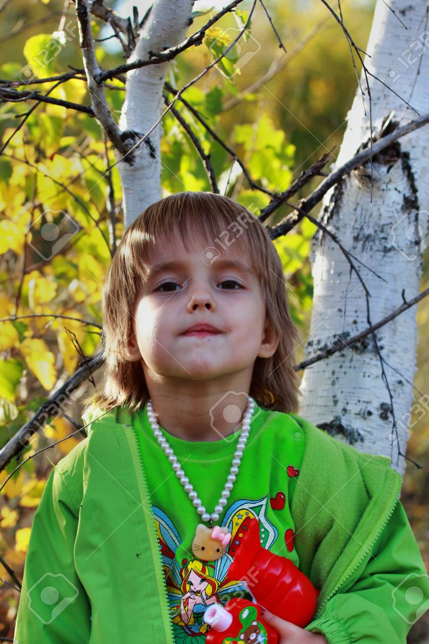 The four-year girl in the autumn forest Stock Photo - 15615060