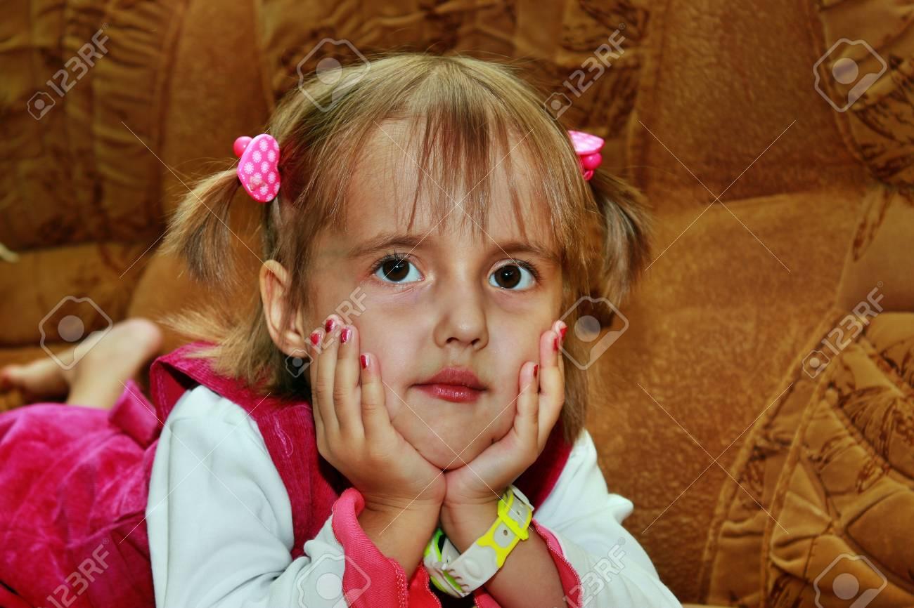 Beautiful little girl lying on the sofa Stock Photo - 15905617
