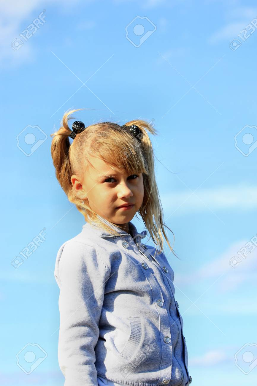 Beautiful girl on a background of blue sky Stock Photo - 16036787