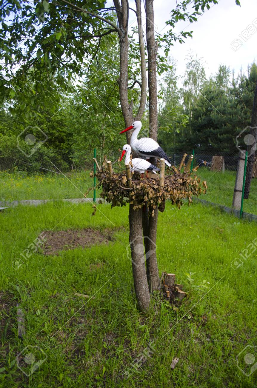 Model of two storks in a nest on a tree Stock Photo - 14229361