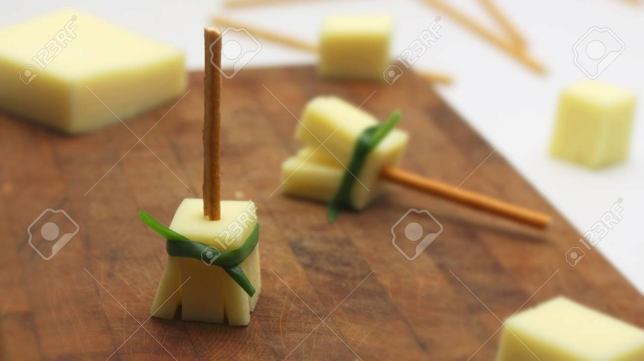 Cheese Broomsticks On A Wooden Cutting Board Healthy Halloween