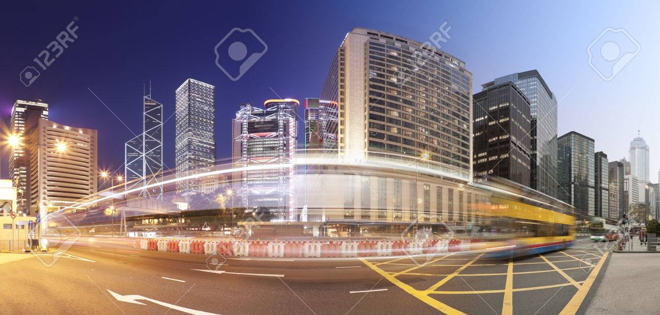 Panorama of a busy road in Hong Kong from day to night, produced