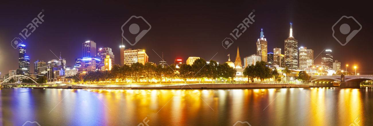 View of buildings along the Yarra river in Melbourne at night,