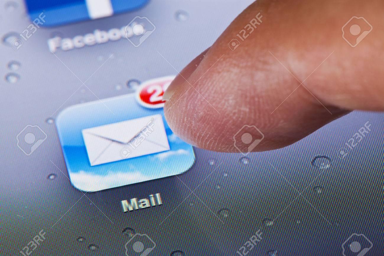 Hong Kong, China - July 23, 2011: Macro image of clicking the mail icon on an iPad screen - 42179352