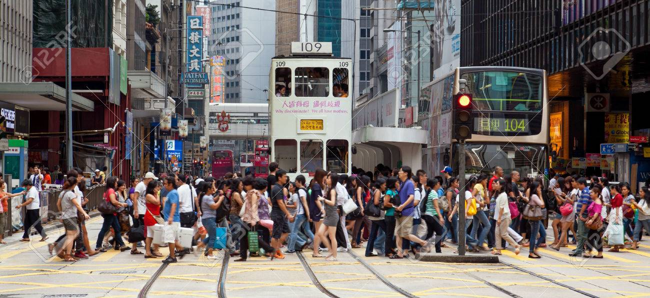 Hong Kong, China - August 21, 2011: Pedestrians crossing a busy crosswalk in Central, Hong Kong. - 42179370