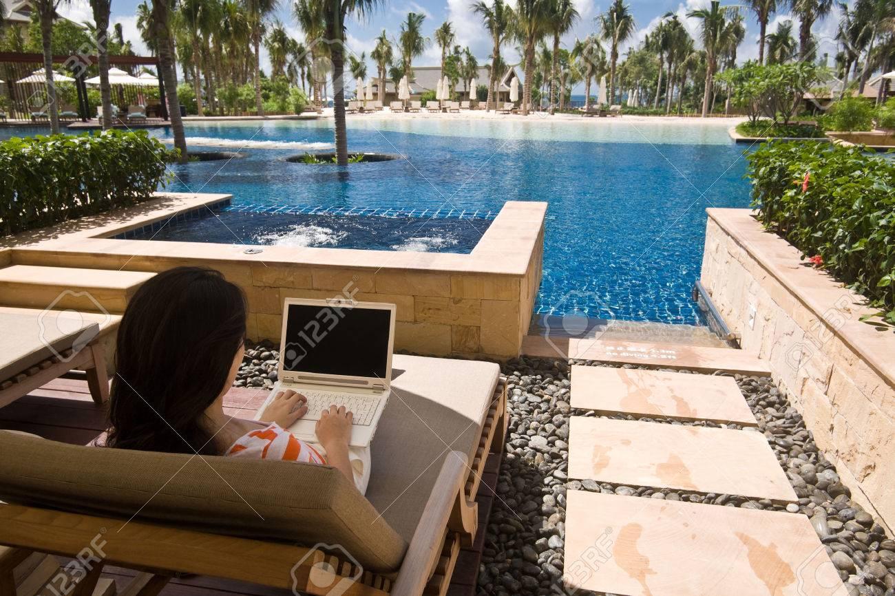 Using a laptop computer at hotel lagoon room - 44330343