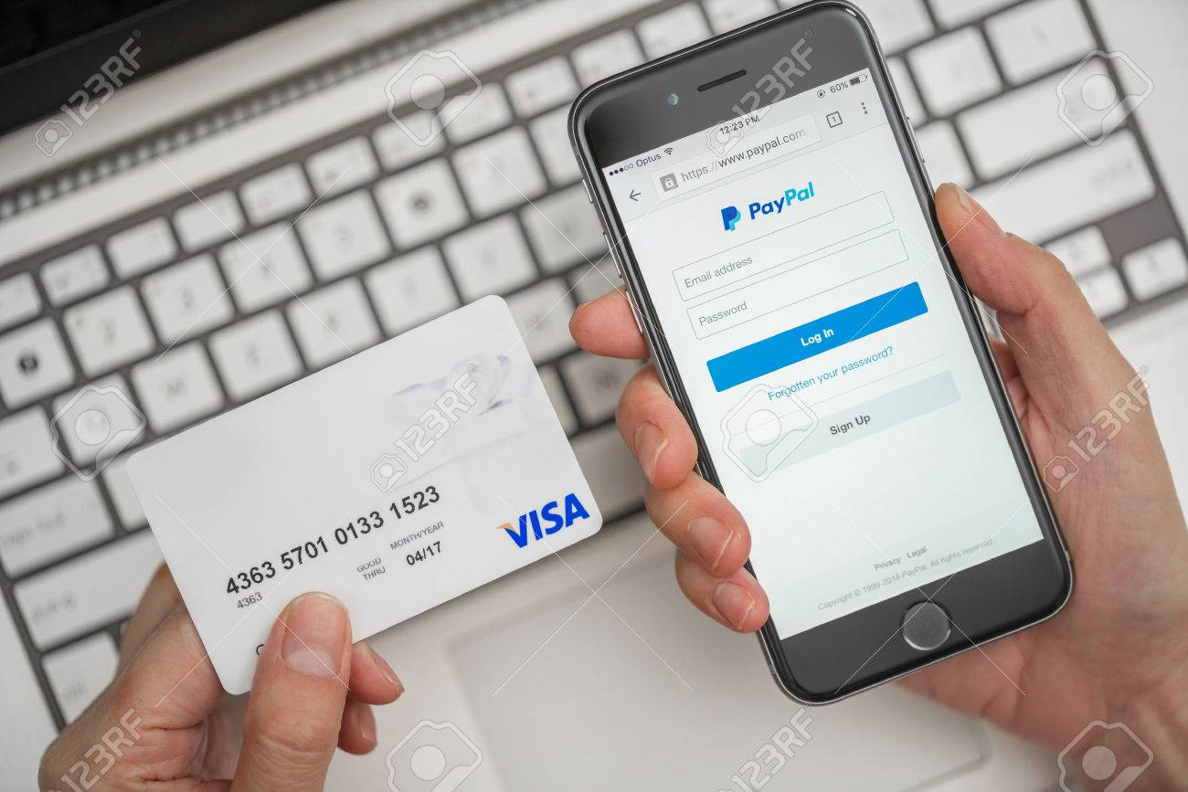Melbourne, Australia - May 10, 2016: Using PayPal and credit card for online shopping. PayPal is a worldwide online payment system and one of the most popular ways of making payment on the Internet. - 56387345