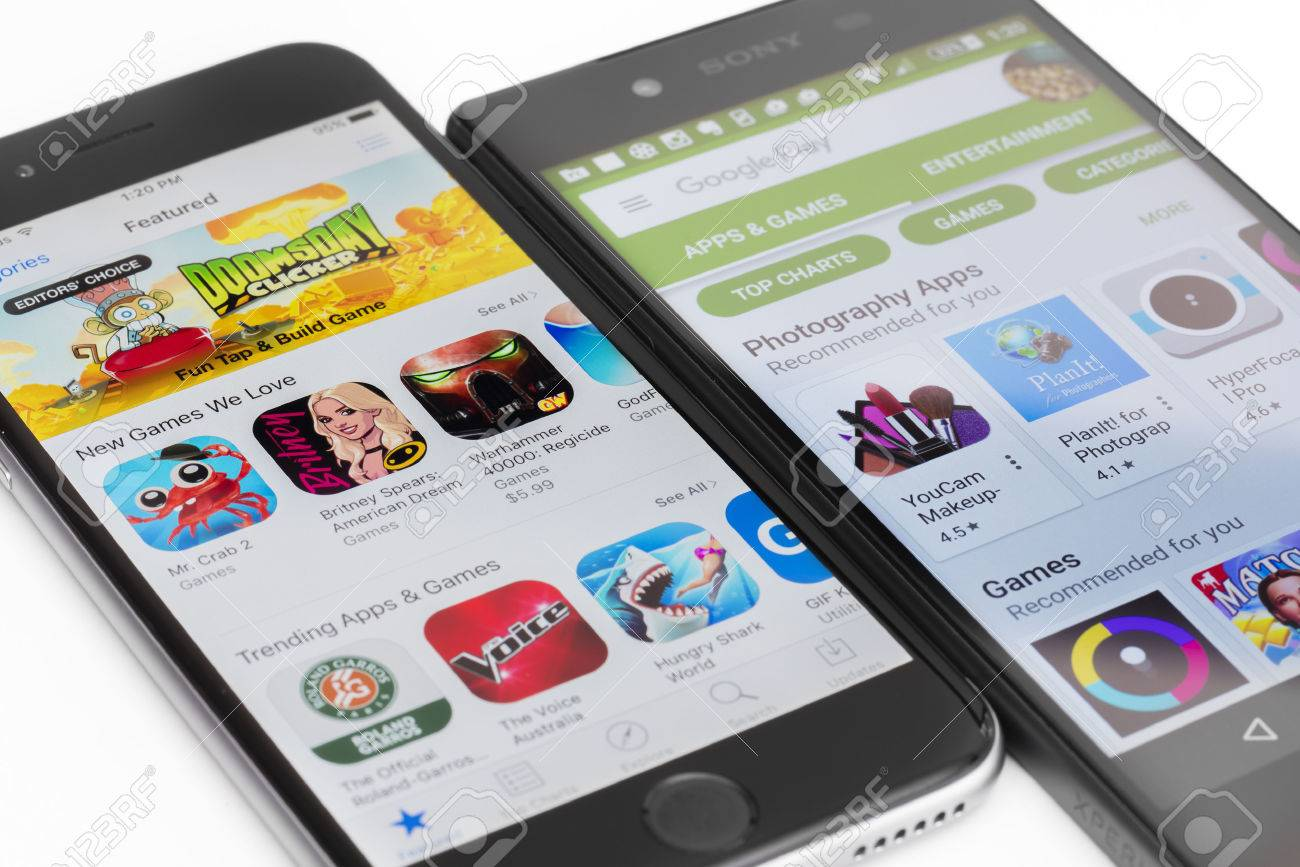 Melbourne, Australia - May 23, 2016: Close-up view of Google Play Store on Android smartphone and Apple's App Store on iPhone. Both stores allow users to download app, music, movies and TV shows. - 57457013
