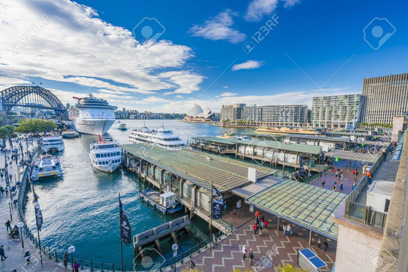 Sydney, Australia - June 23, 2016: People visiting Circular Quay in Sydney CBD, with view of Harbour Bridge and Opera House - 60270388