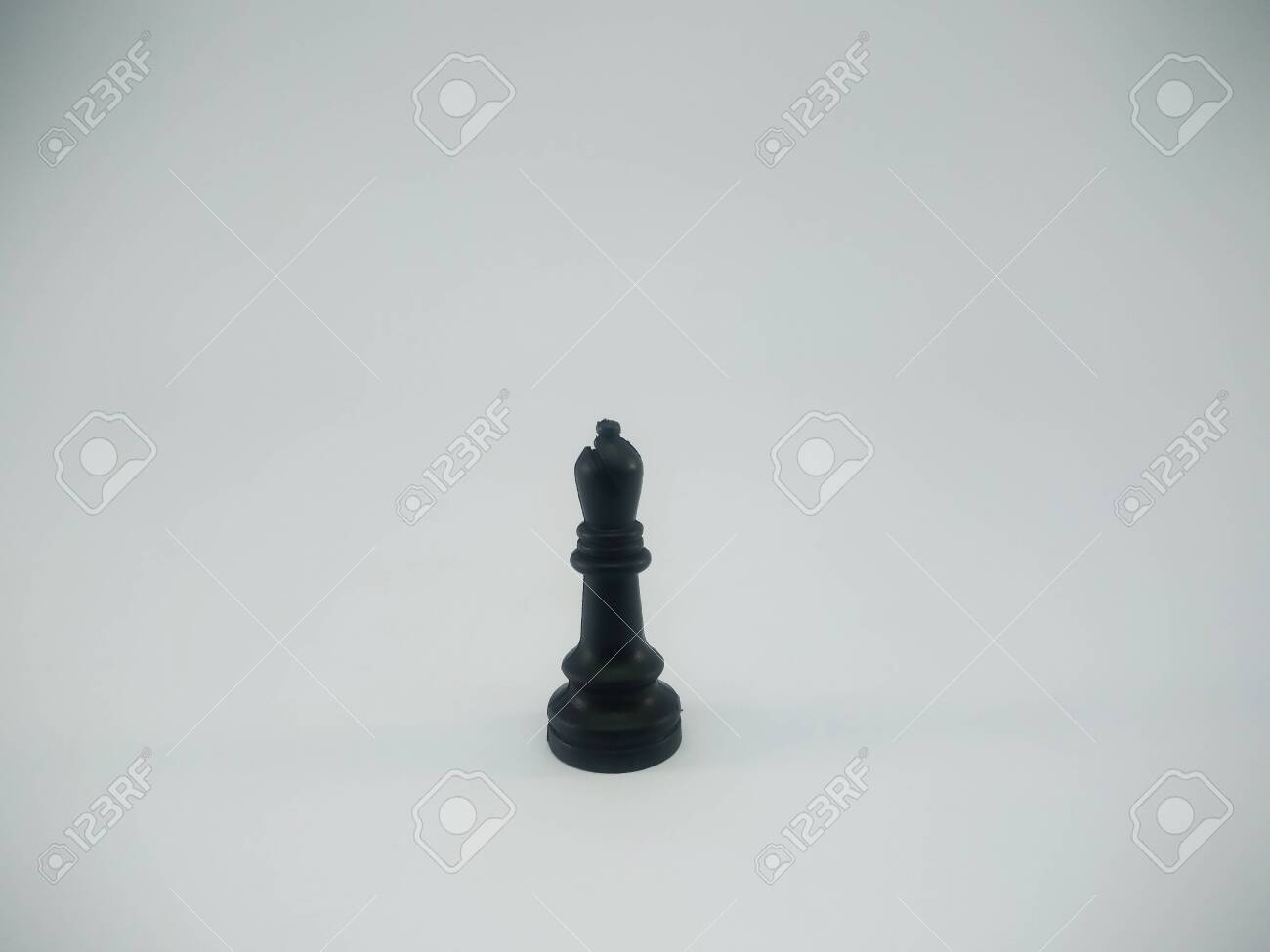 Black plastic bishop chess piece isolated on a white background - 140867025