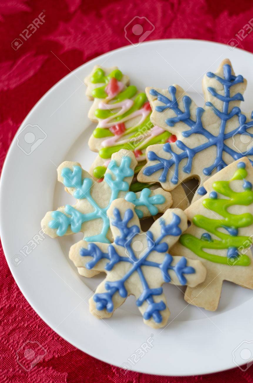 Snowflake And Christmas Tree Shaped Sugar Cookies Decorated With
