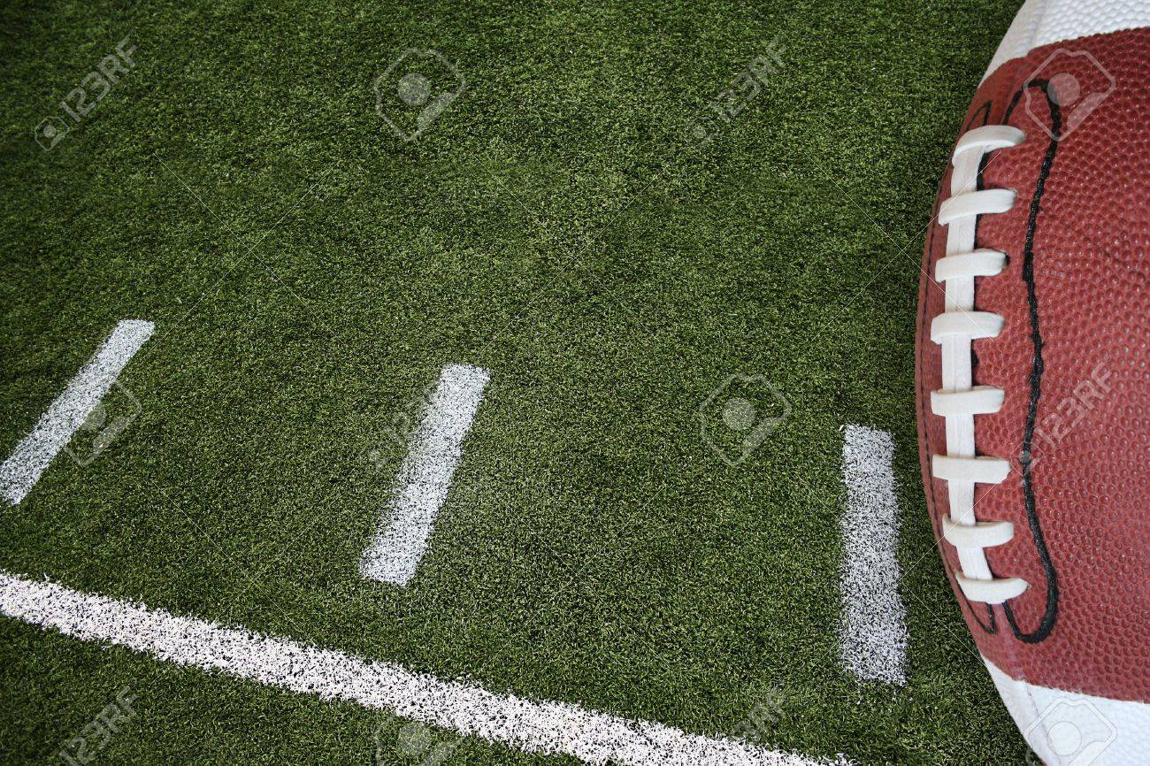A Photo Of An American Football Field Yardage Markings With A