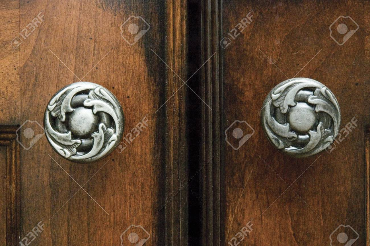 A Close-up View Of Cabinets And Elegant Cabinet Hardware Handles ...