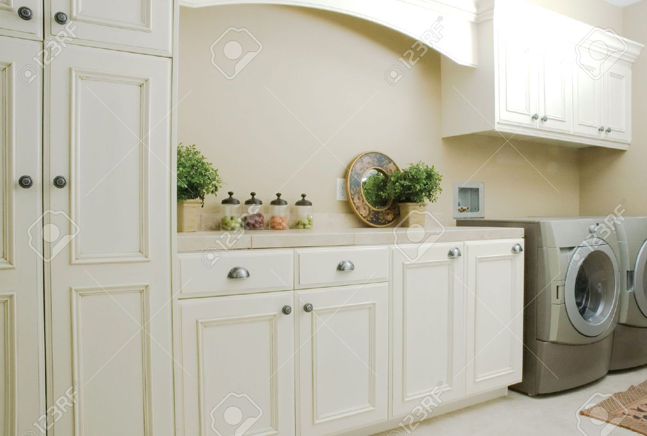 elegant white cabinets in a laundry room stock photo, picture and
