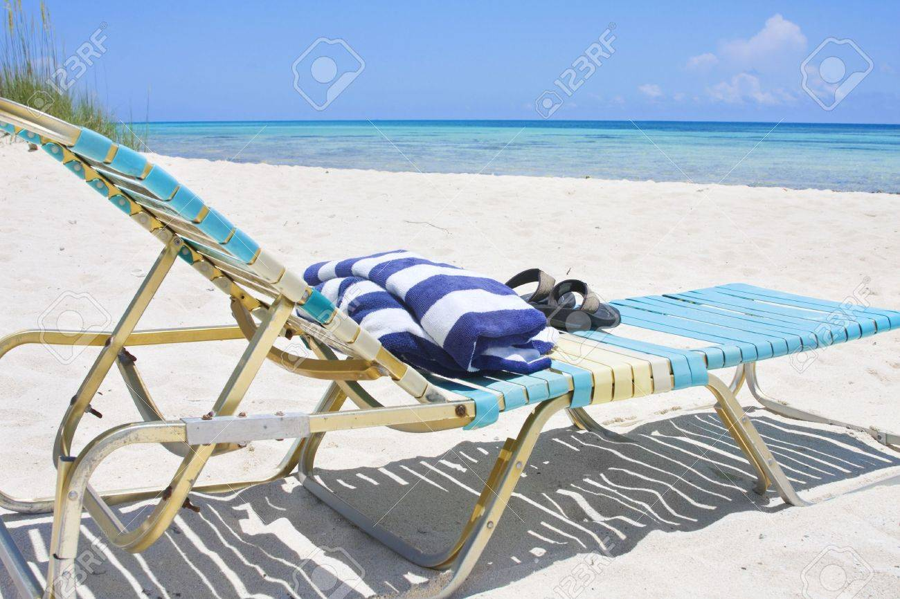 Flip Flop Chair An Inviting Lounge Chair With Towel And Flip Flops Sitting On