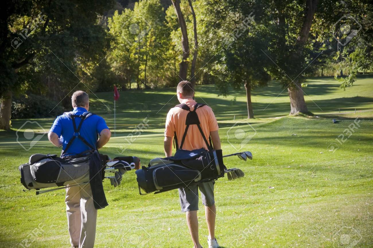Golfers walking on the Golf Course Stock Photo - 9784018