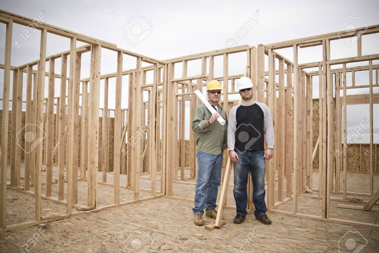building contractors on a job site wide angle stock photo picture building contractors on a job site wide angle stock photo 9784163