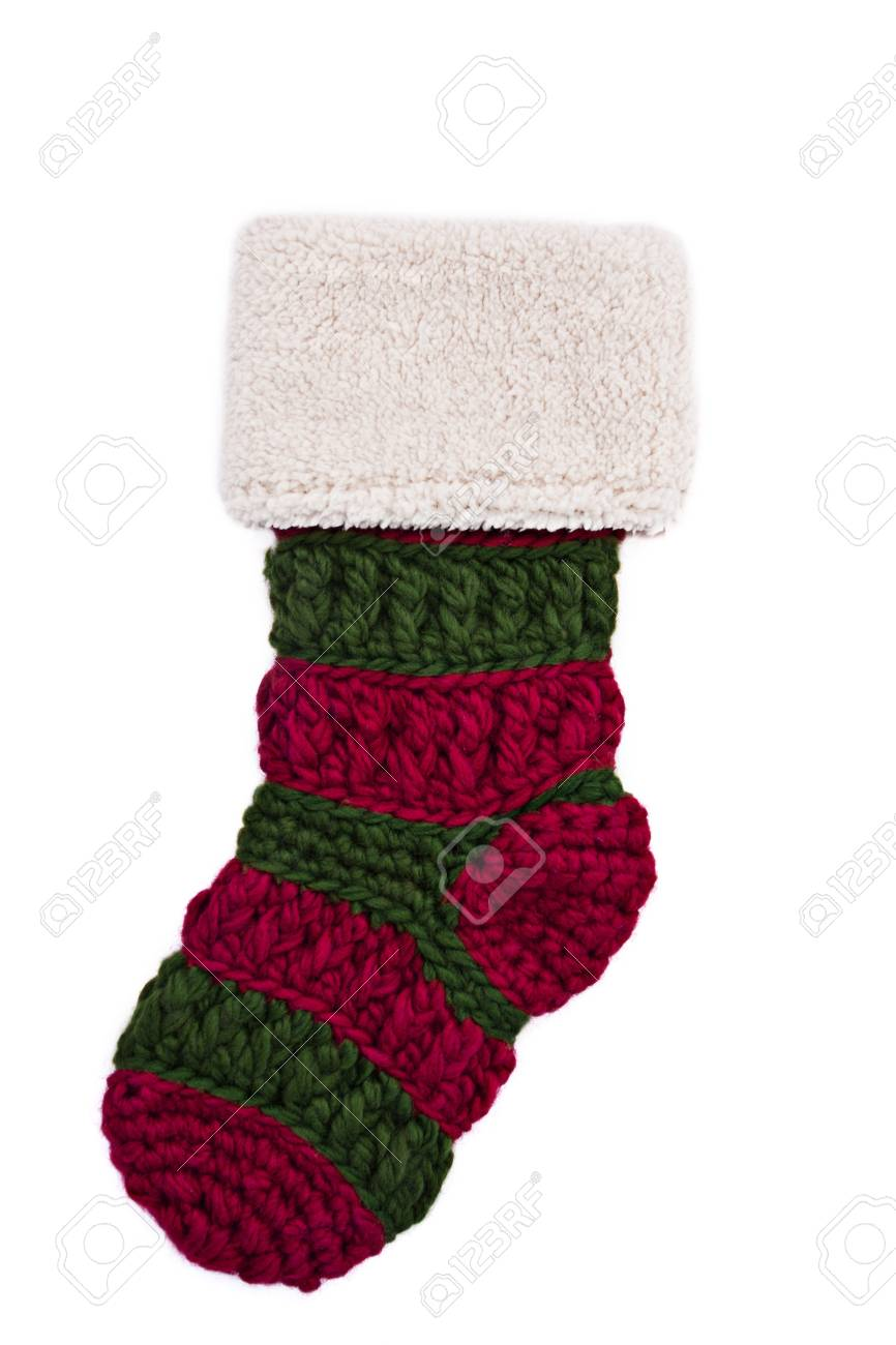 A handmade knitted Christmas stocking isolated on a white background Stock Photo - 12035741
