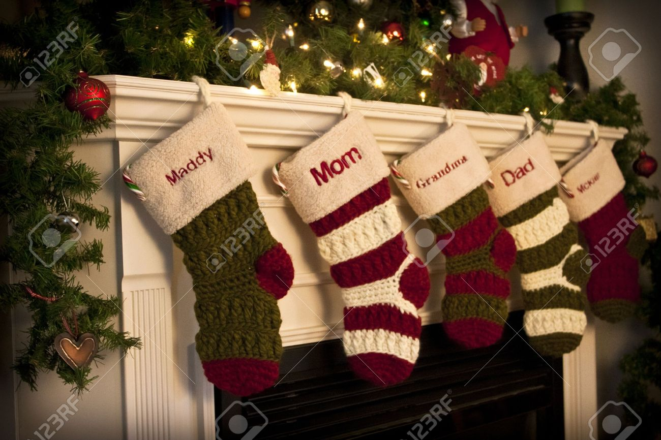 christmas stockings by the fireplace stock photo picture and