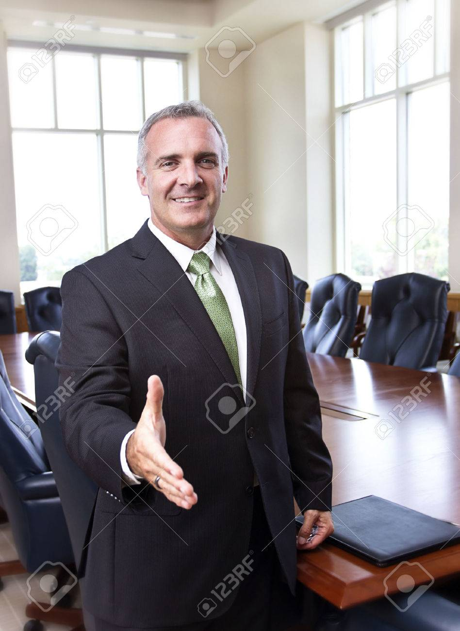 Businessman ready to shake hands Stock Photo - 22251996